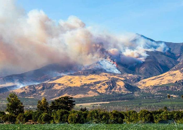Wildfires burn in California hills
