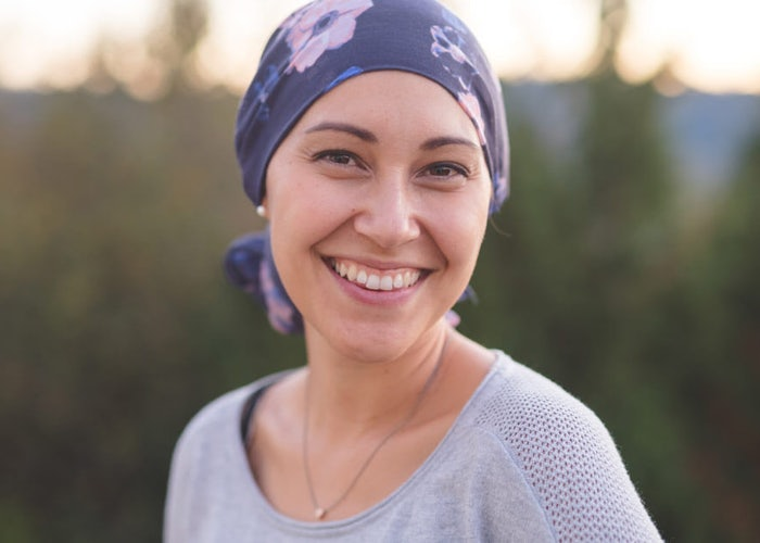 Young woman fighting cancer with optimism