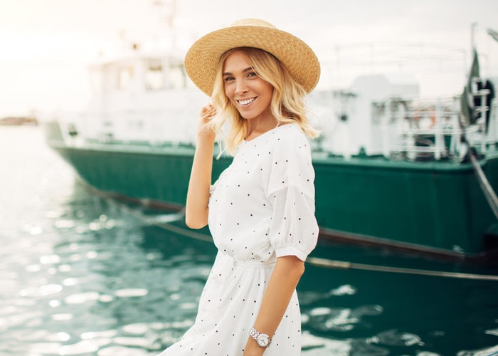 Healthy woman smiling on a dock
