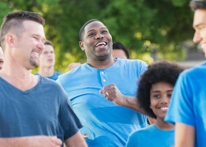 Group of men wearing blue shirts
