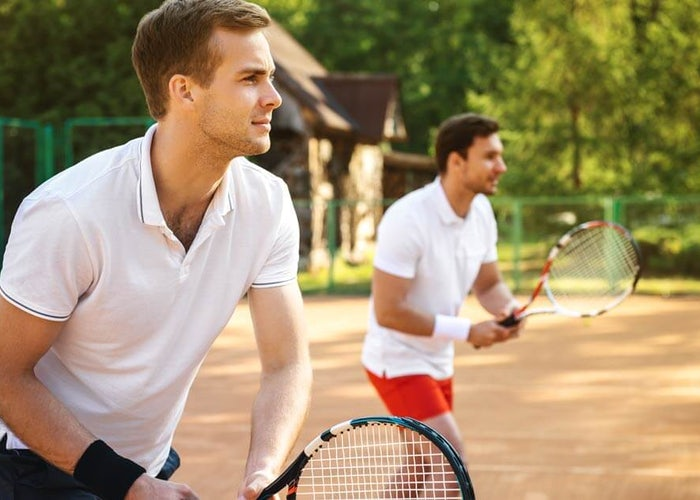 men playing doubles tennis